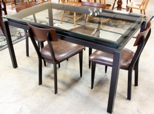 Black dining set available at Upscale Consignment