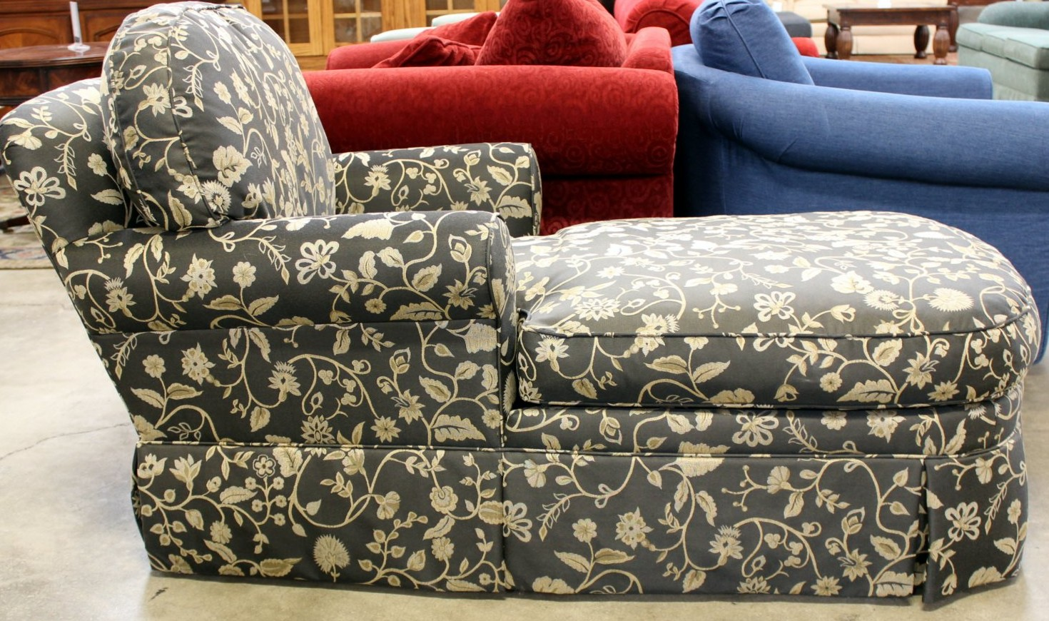 Black floral chaise lounge available at Upscale Consignment