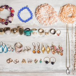 Organized set  of jewelry laid out on table